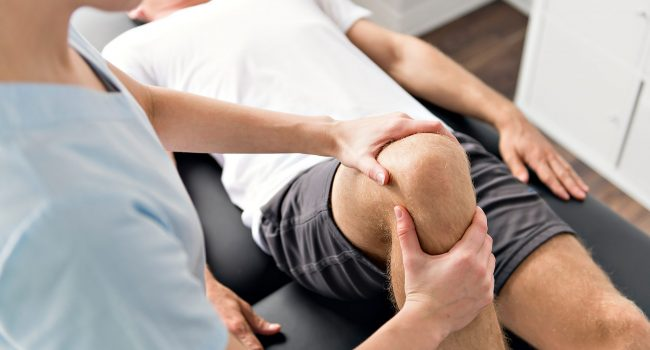 patient-at-the-physiotherapy-doing-physical-exercises